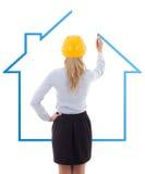 Задний взгляд дома чертежа архитектора женщины изолированного на белизне Стоковое Изображение