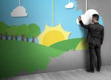Задний взгляд природы чертежа человека на бетонной стене Стоковое Изображение