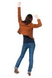 Задний взгляд радостной женщины празднуя руки победы вверх Стоковое фото RF