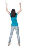Задний взгляд радостной женщины празднуя руки победы вверх Стоковые Изображения RF