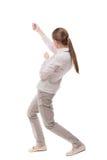Задний взгляд стоящей девушки вытягивая веревочку от верхней части или льнет Стоковое фото RF