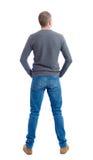 Задний взгляд человека в джинсах Стоковое Изображение RF