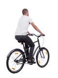 Задний взгляд человека с велосипедом Стоковая Фотография