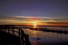 Задний заход солнца залива стоковая фотография rf