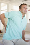 задняя боль человека Стоковая Фотография