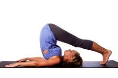 Задняя женщина красоты йоги простирания Стоковое Фото