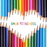 задняя школа принципиальной схемы к цветастые карандаши Стоковые Фото
