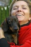 за пятьдесят собаки ее женщина Стоковая Фотография RF