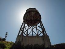за сразу вне заржаветой водой башни солнца Стоковые Фотографии RF
