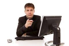 за столом бизнесмена указывая сидящ вы Стоковые Фото