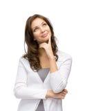 Задумчивая милая женщина касаясь ее стороне стоковые фото