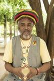Задумчивый кубинский человек с крышкой rastafari Стоковое фото RF