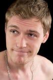 Задумчивый смешной молодой человек стоковые изображения rf