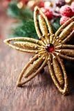 звезда рождества предпосылки золотистая деревянная Стоковое Изображение