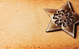 звезда рождества предпосылки золотистая старая бумажная Стоковая Фотография