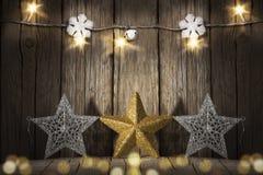 Звезды рождества на деревянной предпосылке Стоковое Фото