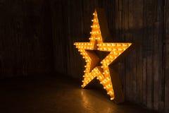 Звезда золота фото с светами Стоковое Изображение RF