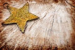 Звезда рождества на деревянной предпосылке Стоковая Фотография