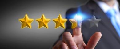 Звезды оценки бизнесмена с его рукой Стоковые Фото