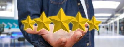 Звезды оценки молодого человека Стоковая Фотография RF