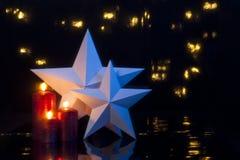 2 звезды перед темной предпосылкой Стоковые Фото