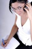 звонок делая телефон примечаний Стоковая Фотография RF