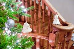 Звон-колокол на рождественской елке Стоковые Изображения