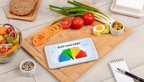 Здоровая еда с таблеткой на деревянной предпосылке Стоковые Фотографии RF
