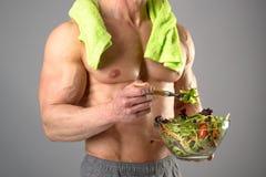 Здоровый человек есть салат Стоковое фото RF