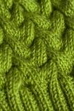 Зеленая вязать предпосылка текстуры ткани или связанная задняя часть картины Стоковое Изображение RF