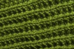 Зеленая вязать предпосылка текстуры ткани или связанная задняя часть картины Стоковое Изображение