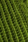 Зеленая вязать предпосылка текстуры ткани или связанная задняя часть картины Стоковые Фото