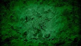 Зеленая и черная затеняемая предпосылка grunge текстурированная стеной стоковое фото