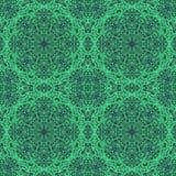 Зеленая картина орнамента на черной предпосылке стоковые фото
