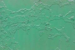 Зеленая металлическая предпосылка с шелушением и треснутой краской Стоковое фото RF