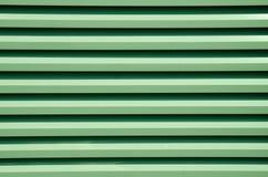 Зеленая предпосылка, нашивки Деталь ворот Стоковое Изображение