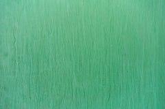 Зеленая предпосылка с расслоинами и пятнами чернил Стоковые Изображения