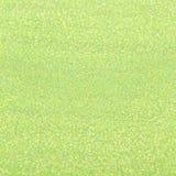 Зеленая сияющая текстура, sequins с предпосылкой нерезкости Стоковая Фотография