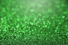 Зеленая яркая абстрактная предпосылка bokeh Стоковое Изображение