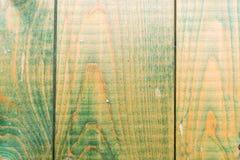 Зеленоватая деревянная предпосылка стоковое фото