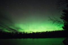 Зеленое зарево - северное сияние Стоковая Фотография