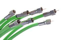 Зеленое кабельное телевидение коаксиальных кабелей с разъемами Стоковая Фотография
