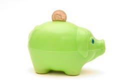 зеленое piggybank Стоковые Изображения
