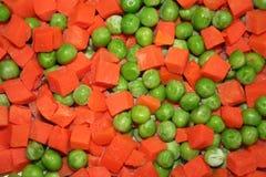 Зеленые горохи от моркови Стоковое фото RF