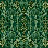Зеленые и золотые листья на изумрудной предпосылке Стоковое Фото