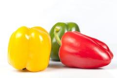 Зеленые красные и желтые изолированные перцы Стоковая Фотография RF