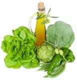 Зеленые овощи и оливковое масло стоковые фото