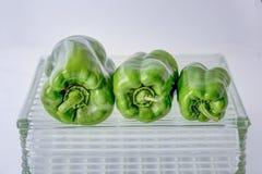 Зеленые перцы на стекле Стоковые Фотографии RF
