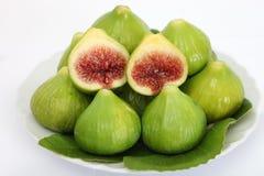 Зеленые смоквы на белизне Стоковые Изображения