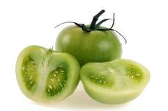 Зеленые томаты, одно чего режет в половине стоковое изображение rf